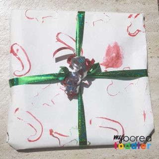toddler painted christmas wrapping paper finished proudct