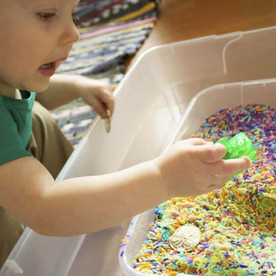 toddler with shamrock leprechaun gold digging st patricks day sensory play