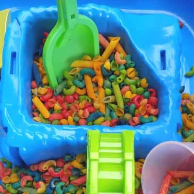 colored pasta sensory bin