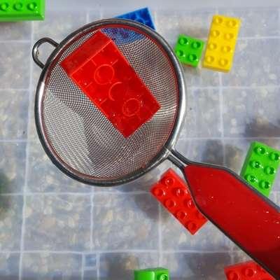 scooping blocks sensory bin image 1
