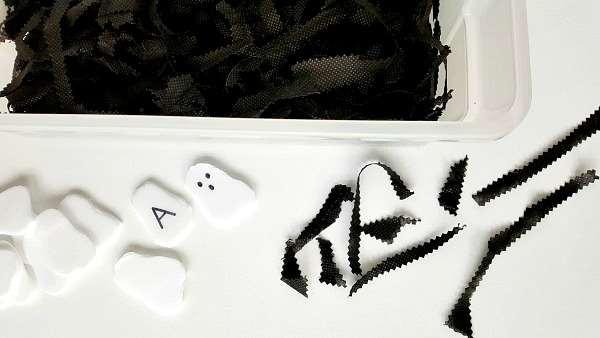 Halloween ghost sensory bin setup for toddler activity
