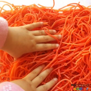 Making colored spaghetti for messy play and sensory bins