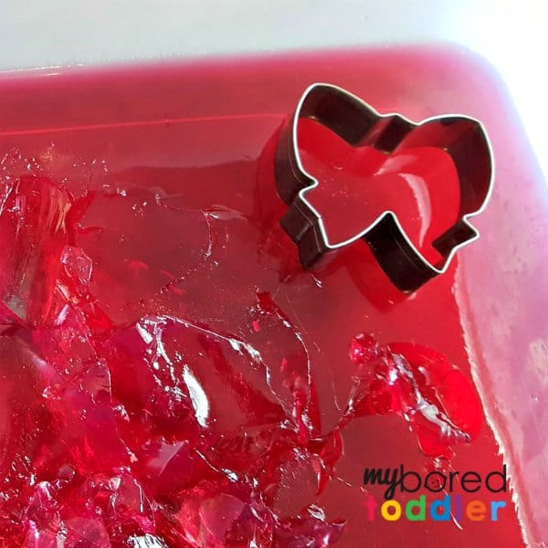 using playdough cutters in jello jelly sensory and messy play