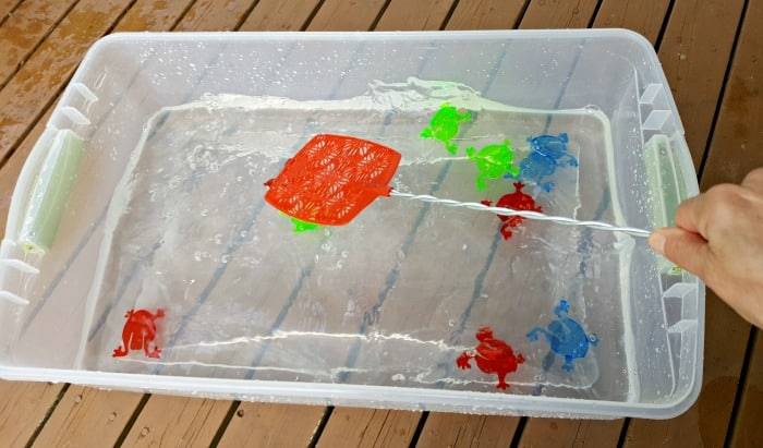 splashing with a fly swatter water play