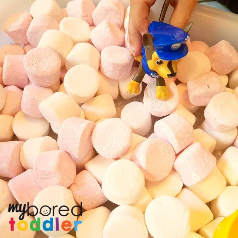 marshmallow sensory bin playing