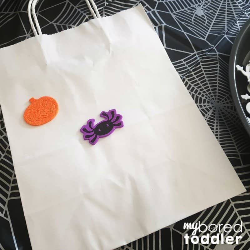 Halloween trick or treat bags craft for toddlers step 1