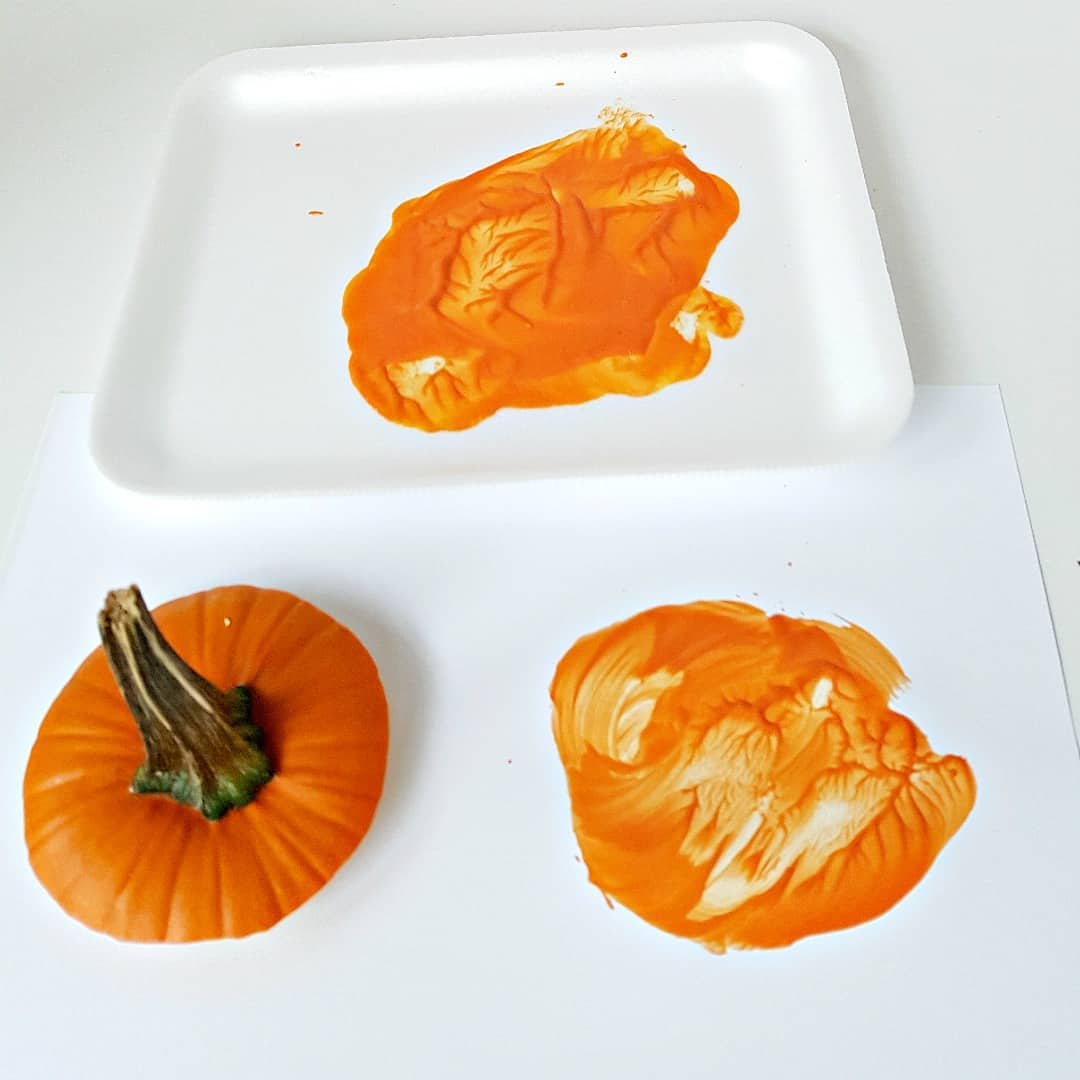 Painting with pumpkin tops
