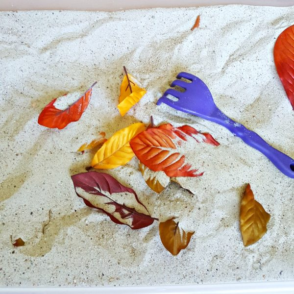Raking leaves fall sandbox activity for toddlers