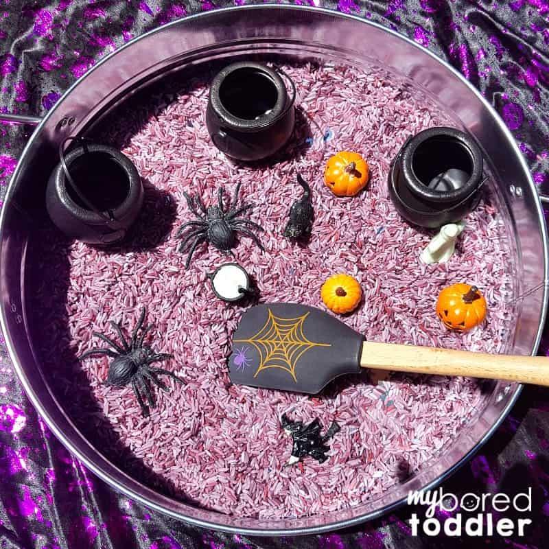 Witch's brew sensory rice bin for Halloween