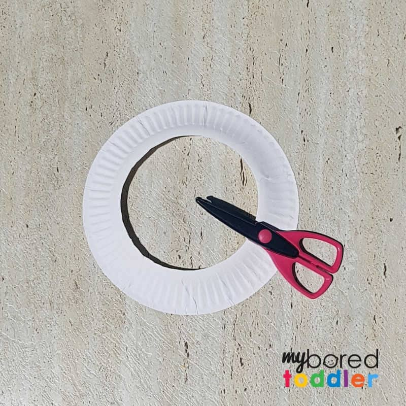easy sticker christmas wreath for toddlers cutting out the plate