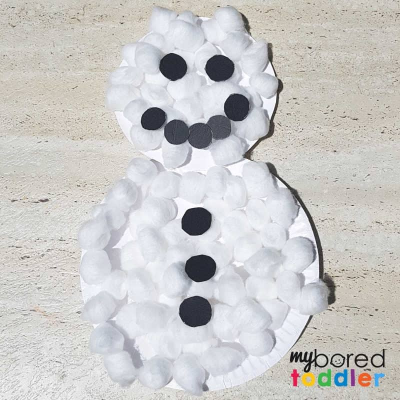 paperplate snowman craft covered in cotton wool balls and black circles