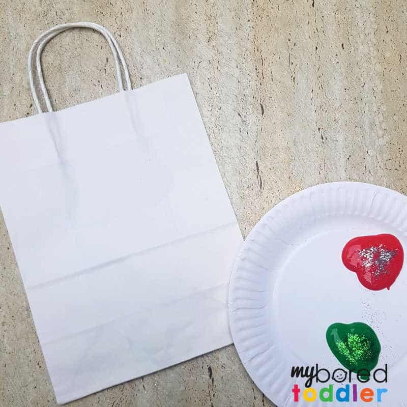 stamped gift bag craft for toddlers and preschoolers setting up the paint