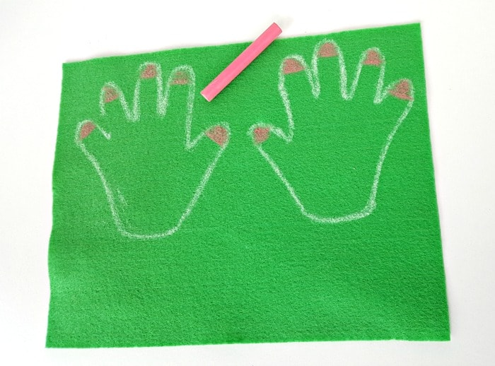 color nails with chalk on felt hand cutouts for the felt board - toddler handprint flower craft for spring