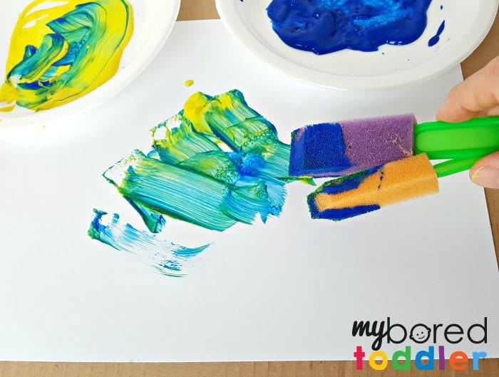 Mixing colors with two paint brushes at a time logo