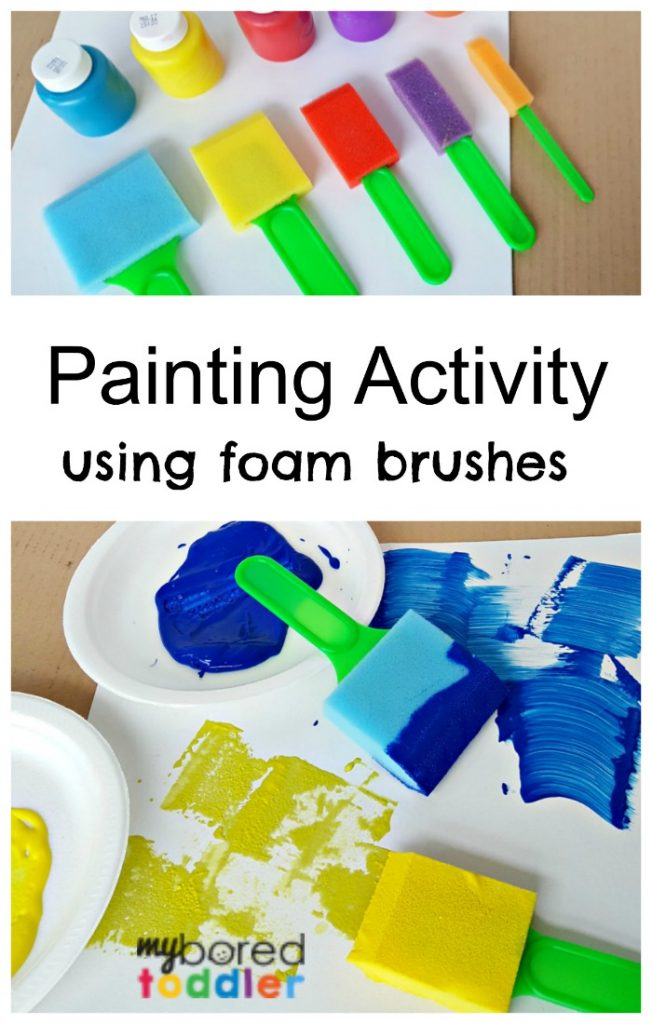 Toddler painting activity using foam brushes in different sizes.