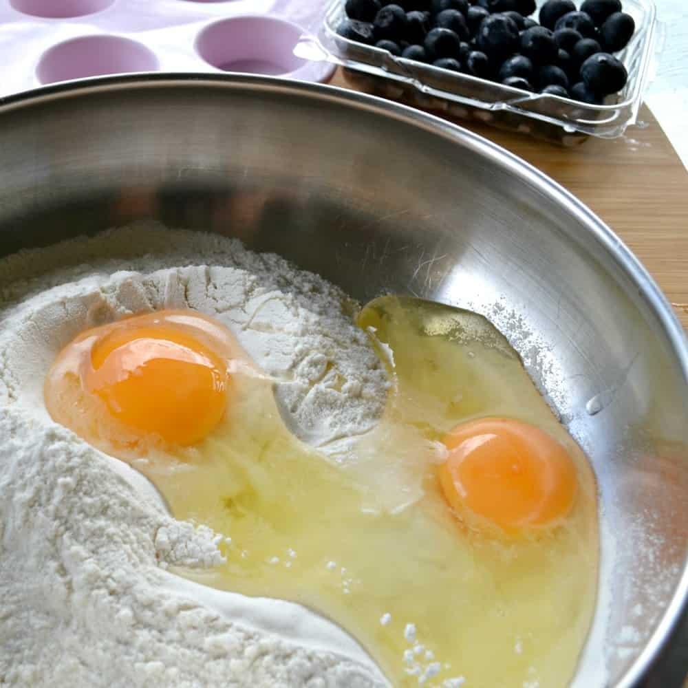 blueberry & strawberry yoghurt mini muffin recipe adding the eggs
