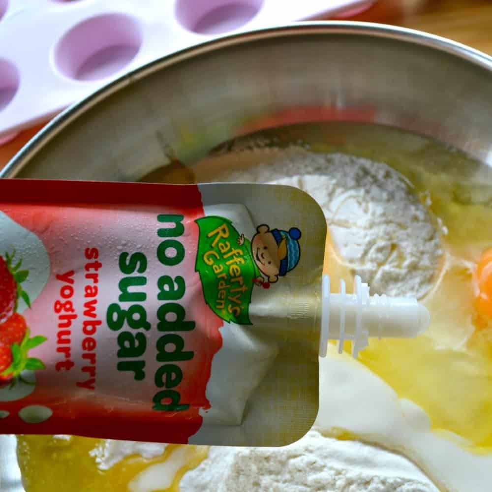 blueberry & strawberry yoghurt mini muffin recipe adding the yoghurt