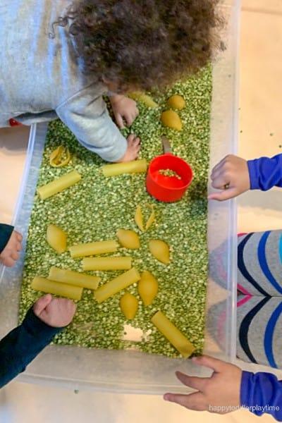 jumbo pasta spring sensory bin for toddlers image 4
