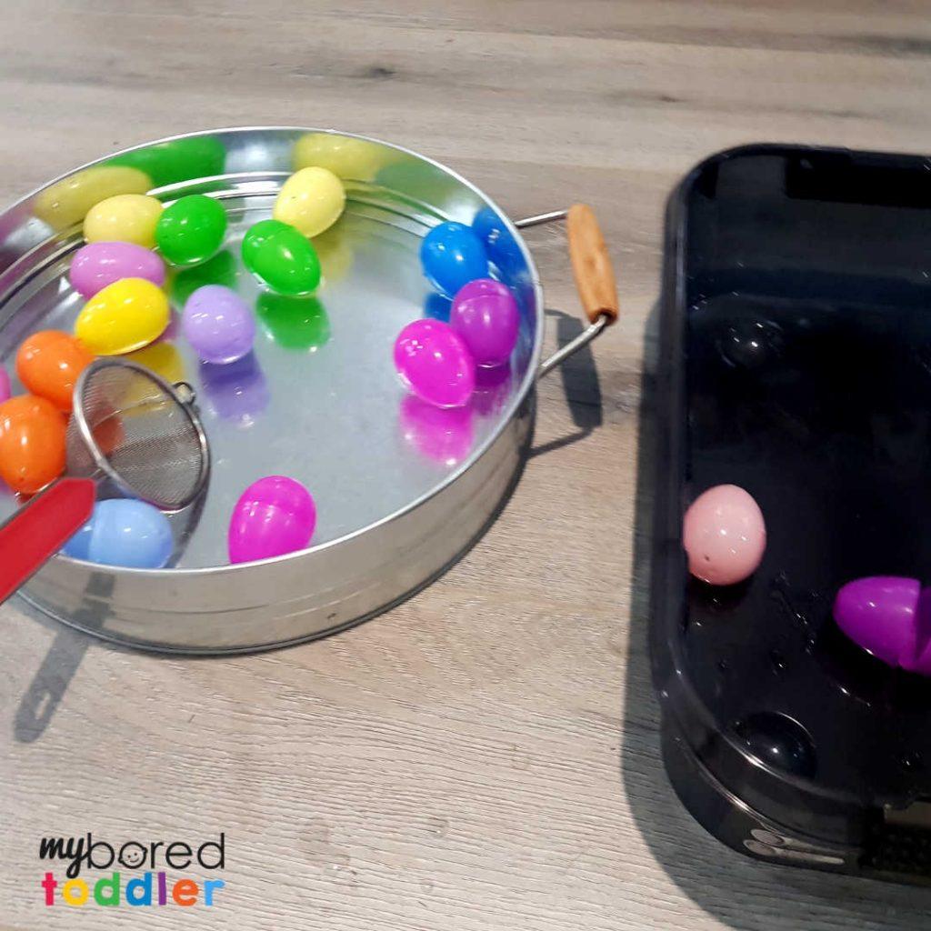 plastic easter egg water scooping sensory bin 4