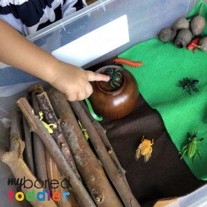 sensory wood pile small world play 3
