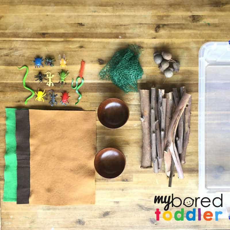 what you need for a sensory wood pile small world play for toddlers