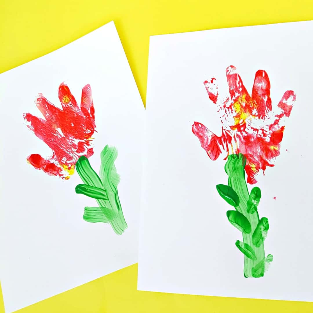 Painting with toddlers hand print flowers