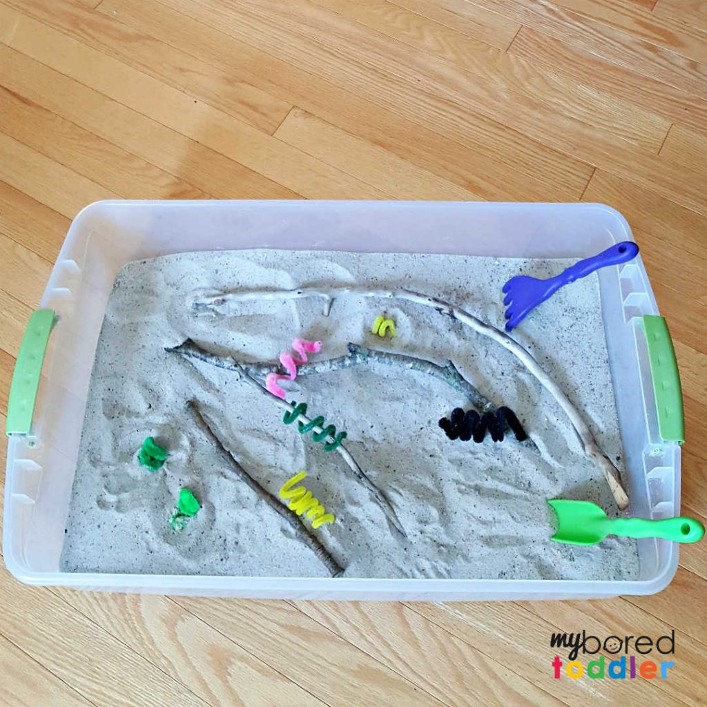 Sandbox summer sensory play with kid-made caterpillars
