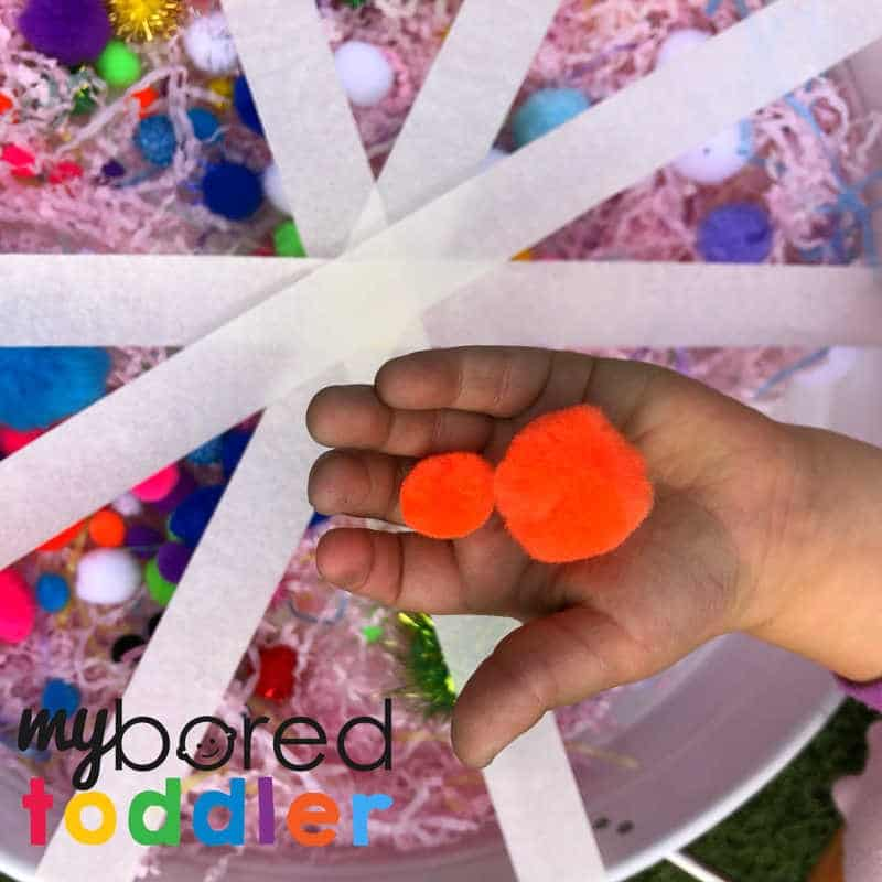 sensory pom pom rescue fine motor play idea for toddlers and preschoolers