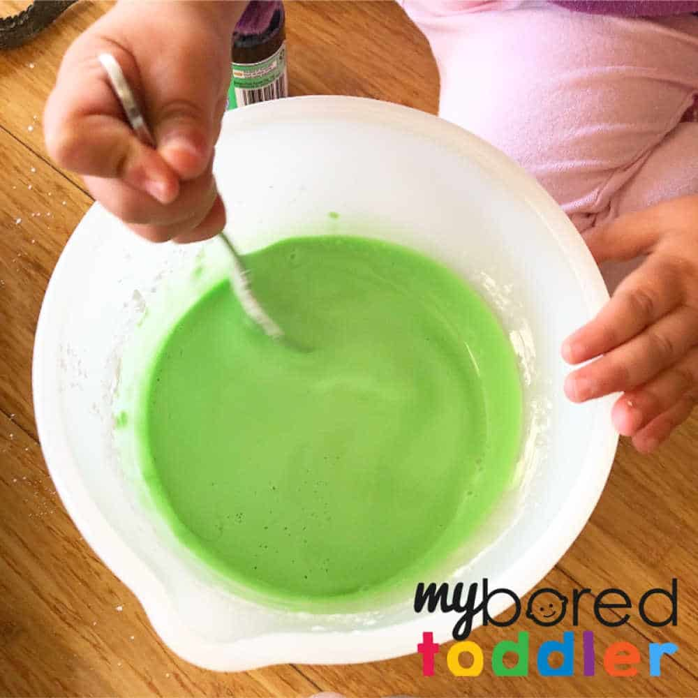 making oobleck for crocodile sensory play for toddlers