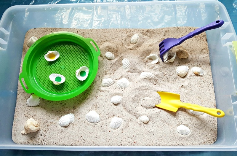 Sandbox sensory bin toddler fine motor activity for summer