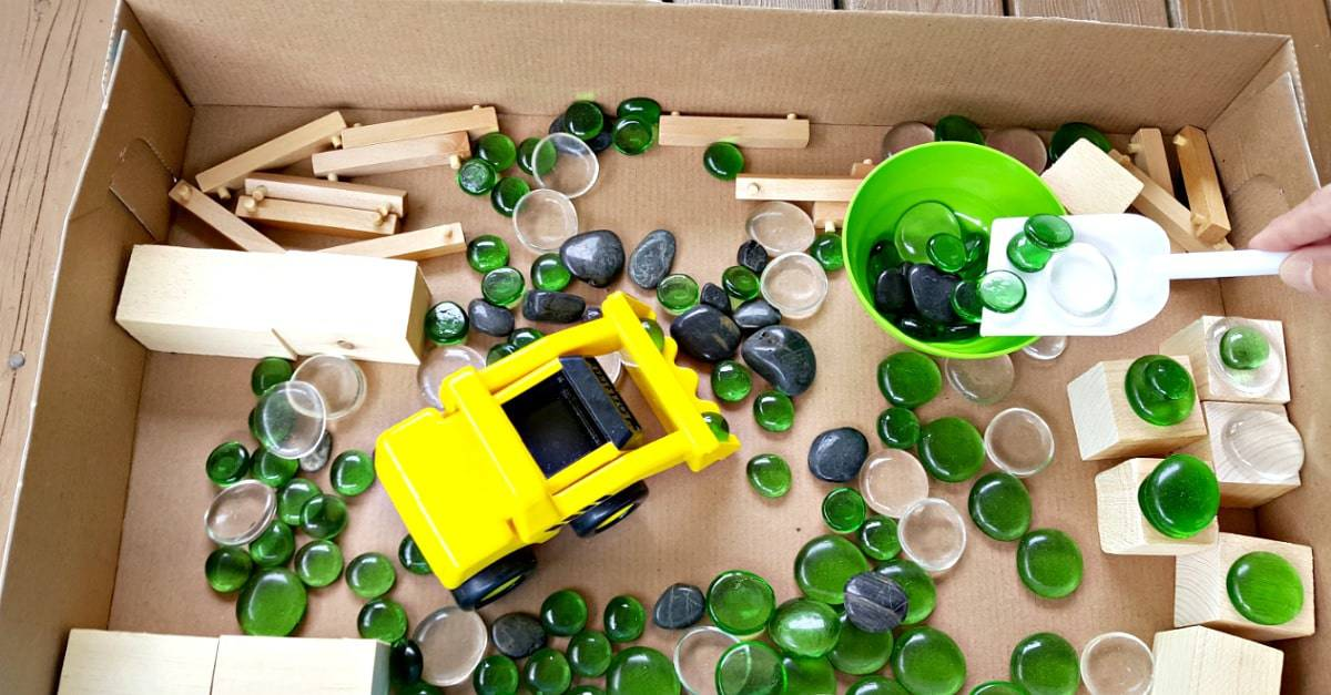 Construction zone cardboard box sensory play for toddlers