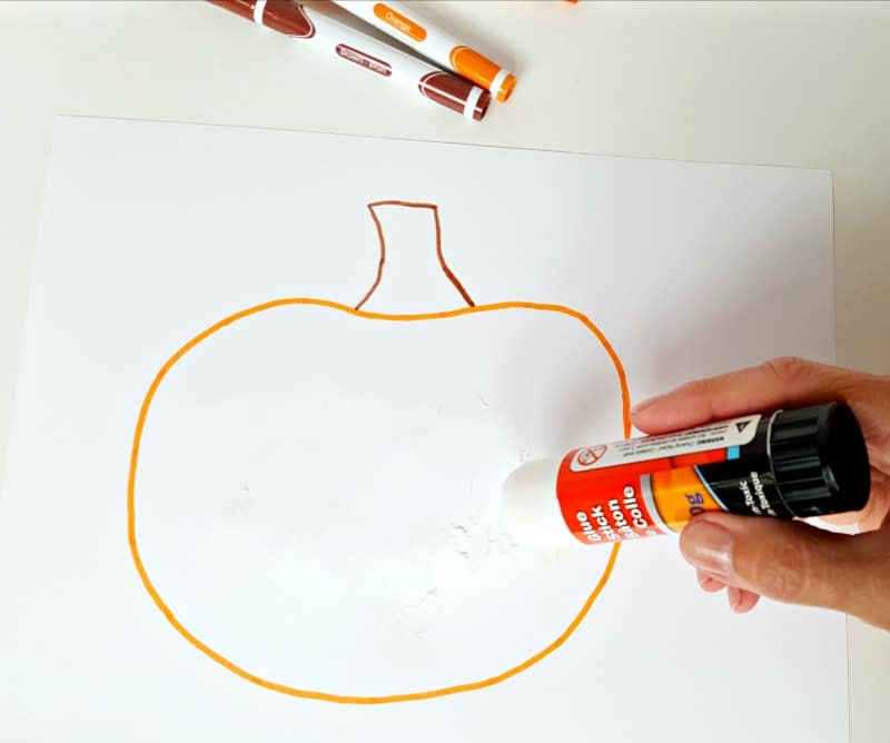 Spread glue onto the pumpkin picture with a glue stick