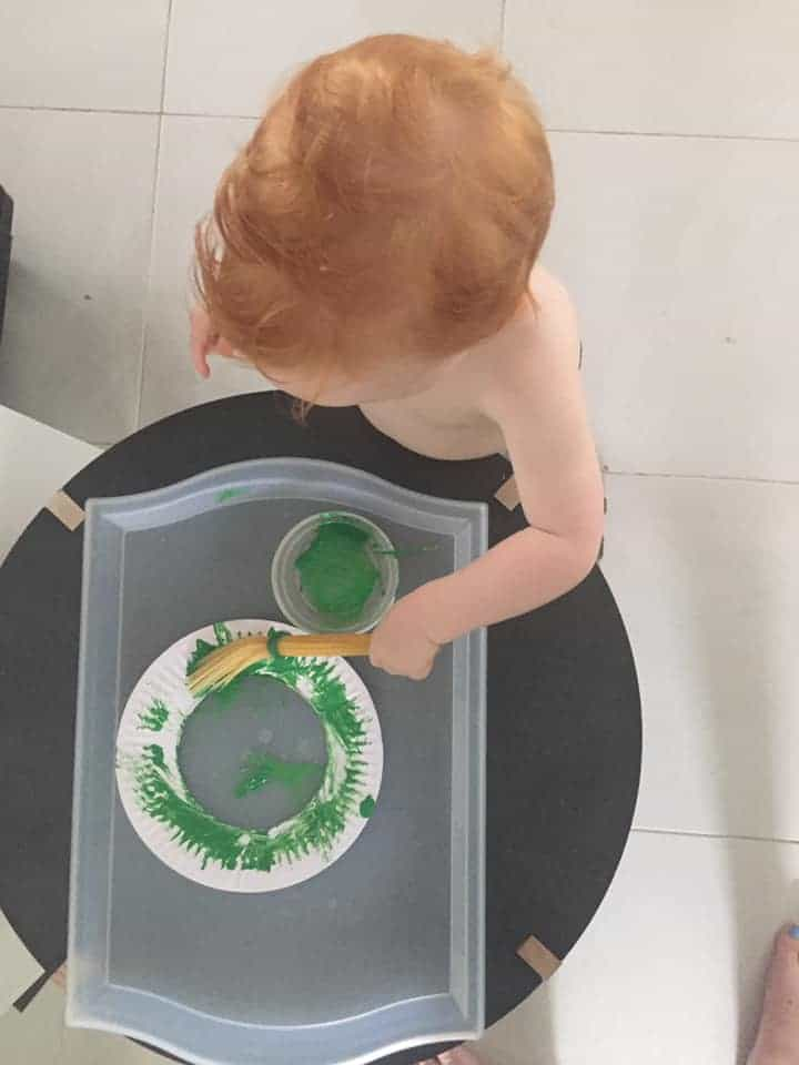 painting with spaghetti to make a Christmas wreath