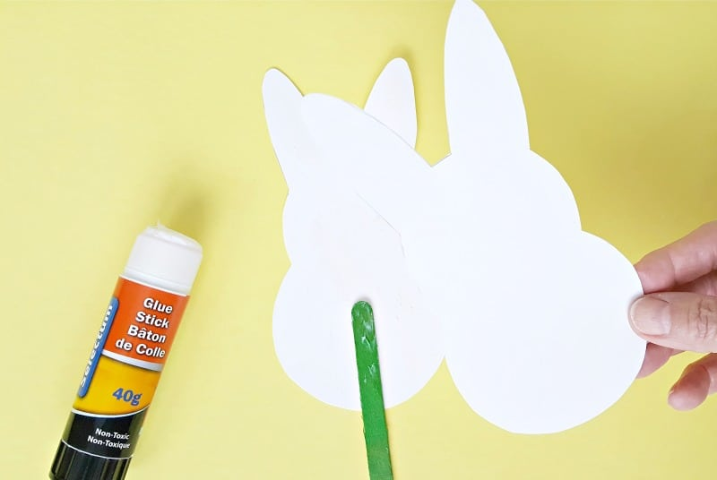 Glue two bunny cut outs together to make a puppet