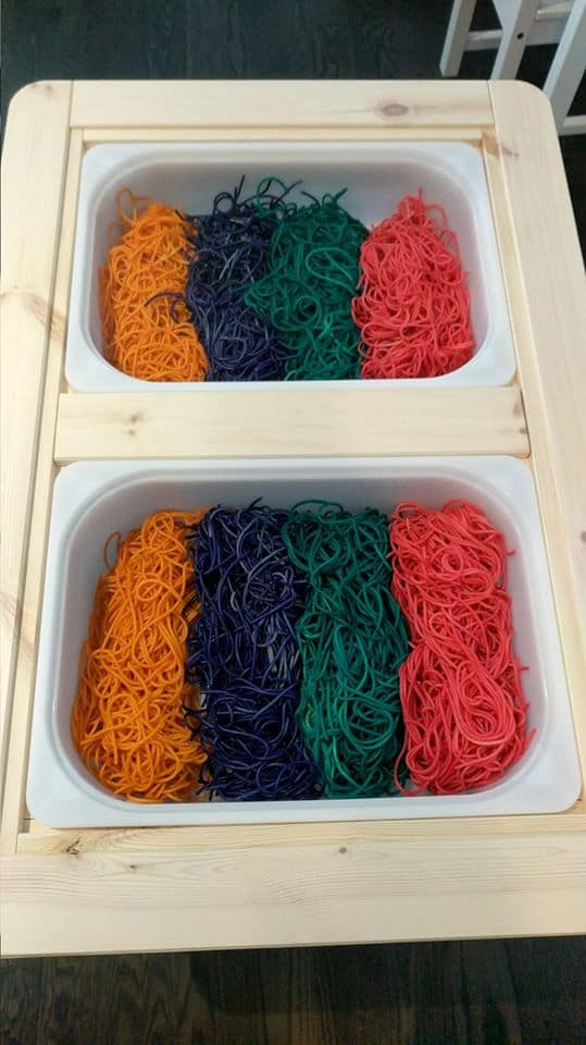 colored spaghetti sensory bin rainbow