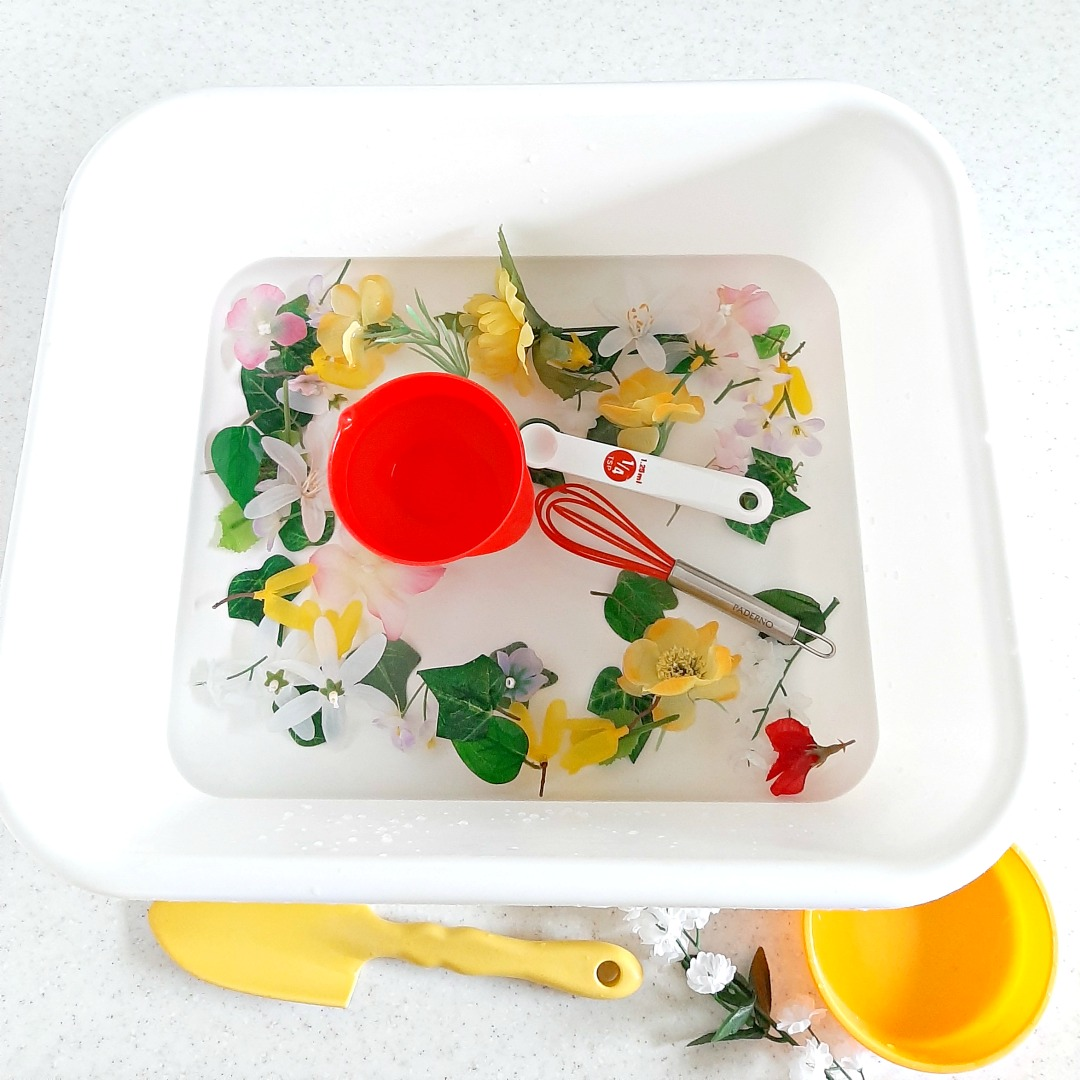 Toddler Water Play with Artificial Flowers